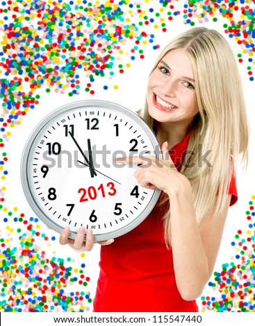 new year 2013. five to twelve. young beautiful woman holding big clock and party decoration