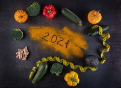 New Year for New Healthy 2021. Fresh vegetable  and healthy food for  fitness for women diet slimming weight loss on rustic  background. Healthy nutrition and health care Concept