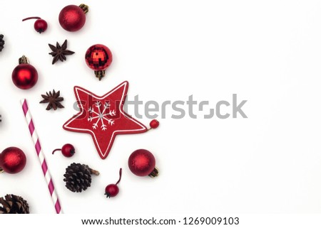 New Year frame of Christmas decorations with fir branches, fir cones, glass balls on white background. Empty space for text. Flat lay, top view.  #1269009103