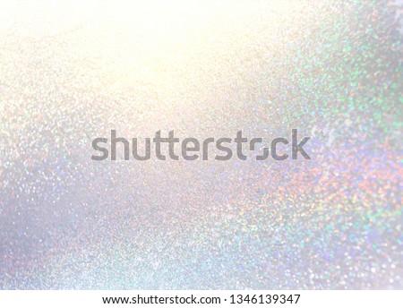 New year glitter background. Shimmer silver backdrop. Diamond sparkles texture. Winter holiday glitz decor. Brilliance pattern.