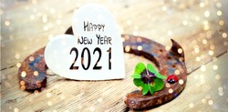 New year greeting card - horseshoe with leaf clover and ladybug - Happy New Year 2021