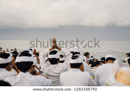 New year in Bali. Holiday melasti. Pilgrims pray at dawn on the ocean. Bali Indonesia March 2018
