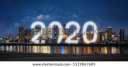 New Year 2020 in the city. Panoramic city at night with starry sky