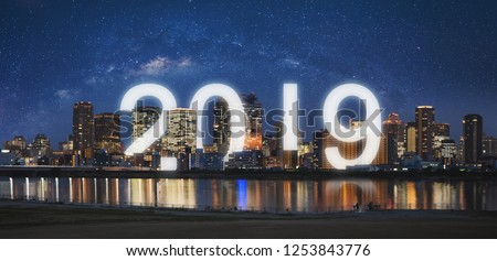 New Year 2019 in the city. Panoramic city at night with starry sky and happy new year 2019 celebration #1253843776
