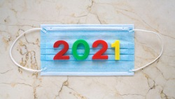 New year 2021 in times of corona virus, letters and corona face mask, symbolic, free copy space