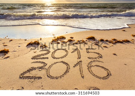 New Year 2016 is coming concept. 2015 and 2016 signs on a beach sand #311694503