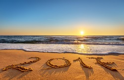 New Year 2017 is coming concept. Happy New Year 2017 replace 2016 concept on the ocean beach