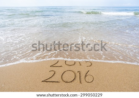 New Year 2016 is coming concept. Happy New Year 2016 replace 2015 concept on the sea beach