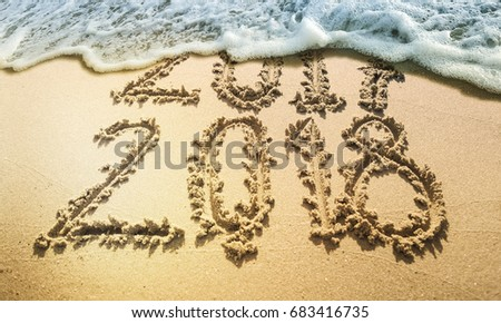 New Year 2018 is coming concept. Happy New Year 2018 replace 2017 concept on the sea beach #683416735