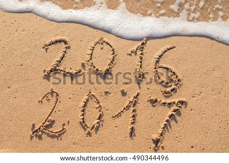 New Year 2017 is coming concept, sandy beach #490344496