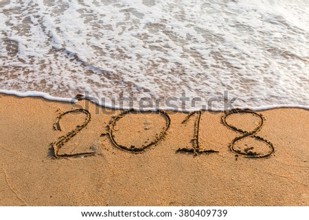 New Year 2018 is coming concept - write  2018 on a beach sand #380409739