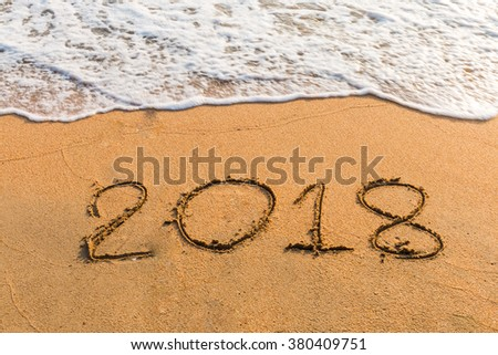 New Year 2018 is coming concept - write  2018 on a beach sand #380409751