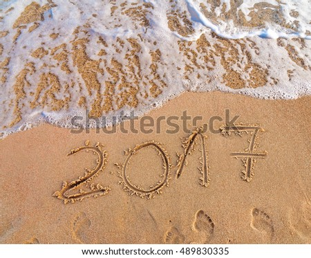 New Year 2017 is coming concept written on sandy beach  #489830335