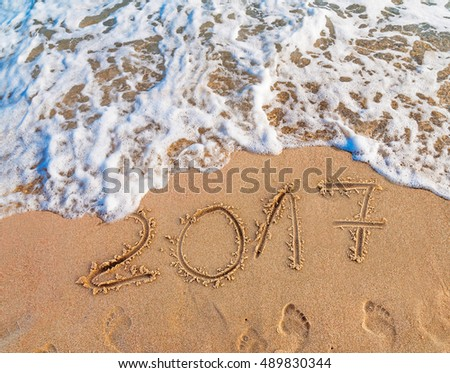 New Year 2017 is coming concept written on sandy beach  #489830344
