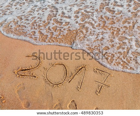 New Year 2017 is coming concept written on sandy beach  #489830353