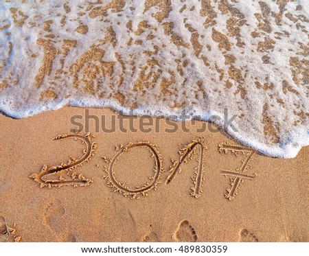 New Year 2017 is coming concept written on sandy beach  #489830359