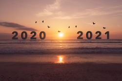 New year 2021 is coming with sunset beach background. New start for planing or set new resolution in life .Business solution.