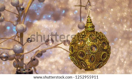 Stock Photo New Year 2019. Light background. New Year mood, Christmas silver tree in vase, Christmas tree toys. Lights, bokeh. festive. Merry Christmas Abstract Blurred Christmas Lights Bokeh Background. 4K.