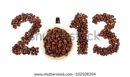 New Year 2013 made of coffee beans and cup on the white background