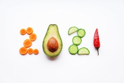 new year 2021 made of food on white background.