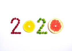 New year 2020 made of fruit and berries on the white background.