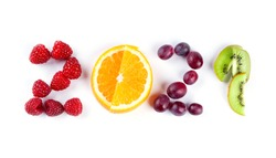 New year 2021 made of fruits on the white background. Healthy food