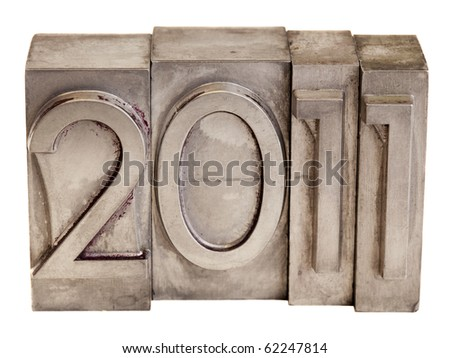 New Year of 2011 - numbers in vintage scratched metal letterpress printing blocks, isolated on white