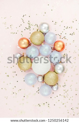 New Year or Christmas pattern flat lay top view Xmas holiday celebration pearl decorative toy balls sparkles confetti pink paper background copy space Template frame for greeting card your text design #1250256142
