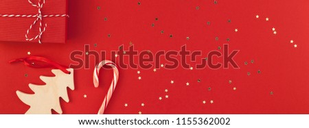 New Year or Christmas presents wrapped ribbon flat lay top view Xmas 2019 holiday celebration handmade gift boxes red paper golden sparkles background copyspace. Template mockup long wide banner #1155362002