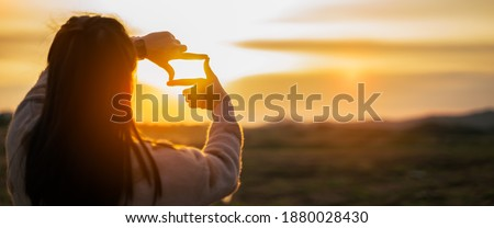 New year 2021 or start straight concept.Blurry of woman making frame round with her hands.Concept of planning and challenge or career path,business strategy,opportunity and change Сток-фото ©