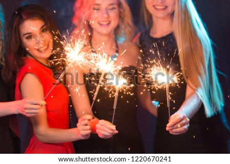 New year party, celebration and holidays concept - group of friends having fun with sparklers #1220670241