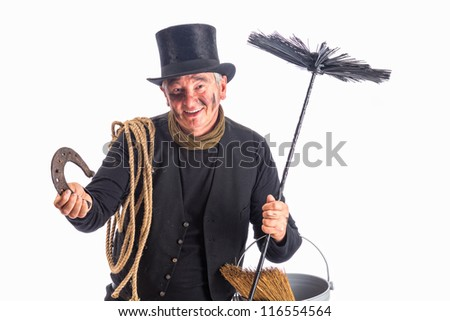 New Year photo of a chimney sweep wishing good fortune with a horseshoe