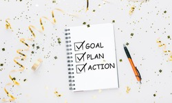 New Year Plans. Notebook With 2021 Goals And Words Plan, Action And Goal Over White Background Decorated With Shiny Confetti. Motivation And Aspiration, Motivational Poster Concept