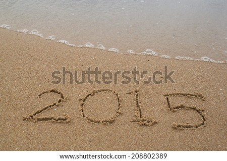 New Year 2015 replace 2014 concept on the sea beach #208802389