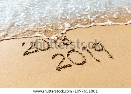 New Year 2019 replace 2018 on the sea beach concept #1097651801