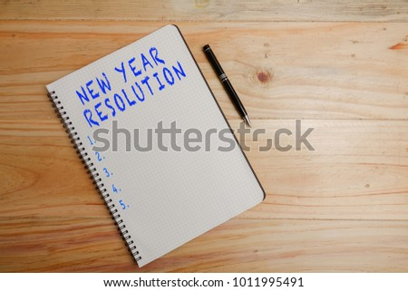 new year resolution blank notepad and coffee cup on office wooden table 1011995491