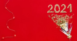 New Year's and Christmas. numbers 2021 from spangles scattered on a red background. Shiny numbers 2021 banner