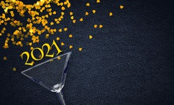 New Year's and Christmas. shiny glass on a black background. Shiny numbers 2021 flat lay