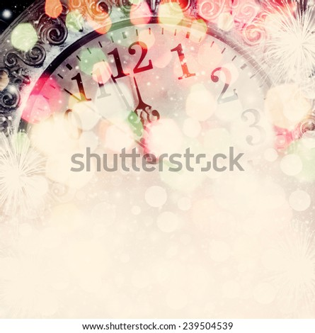 New Year\'s at midnight - clock on bokeh background