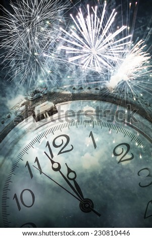 New Year\'s at midnight - Old clock against fireworks