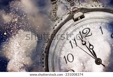 New Year\'s at midnight - Old clock with stars snowflakes and holiday lights