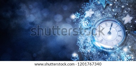 New Year's at midnight - Old clock with stars snowflakes and holiday lights. Christmas and New Year background #1201767340