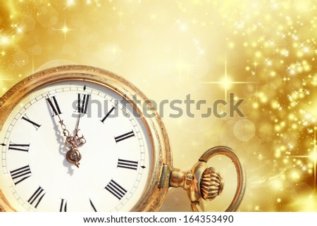 New Year\'s at midnight - Old golden clock with stars and snowflakes
