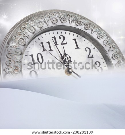 New Year\'s at midnight - old vintage clock and holiday lights