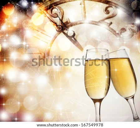 New Year's at midnight with champagne glasses and clock on light background #167549978