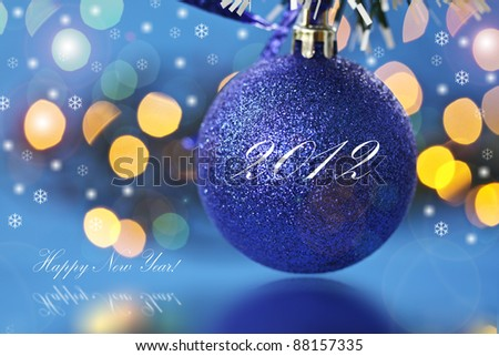 New Year's ball on a blue background abstract