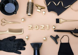 New year's banner with hairdressing tools and figures for 2021.