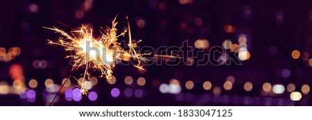 New Year's celebration sparkler at night