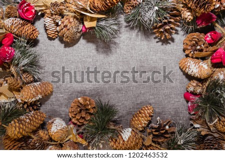New Year's, Christmas decorations on a gray background (coniferous branches, cones) #1202463532