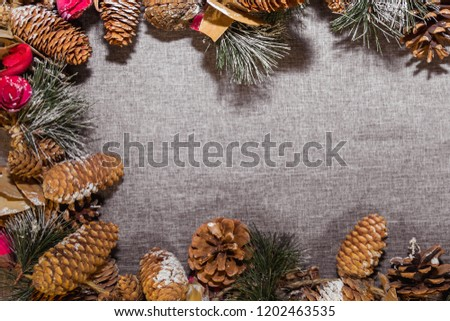 New Year's, Christmas decorations on a gray background (coniferous branches, cones) #1202463535